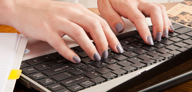 Fingers typing at a keyboard