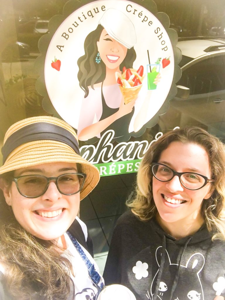E. L. Lane with Madeline from Colorful Cute in front of Stephanie's Crepes sign