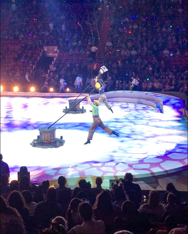 Acrobats spinning on light polls at Disney On Ice presents Road Trip Adventures
