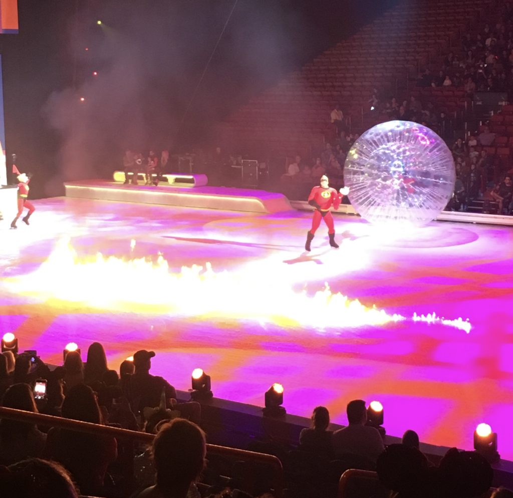 The Incredibles family lights a fire at Disney On Ice presents Road Trip Adventures